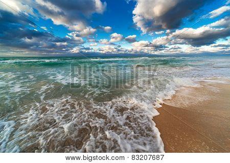 ocean and sandy beach on a sunny day