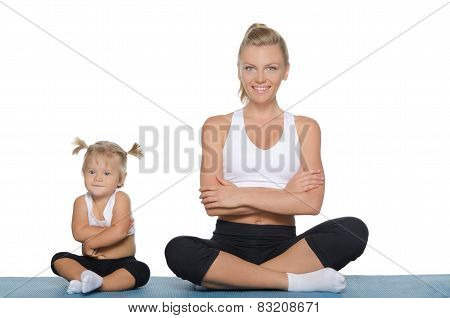Mom And Daughter Engage In Fitness On Mat