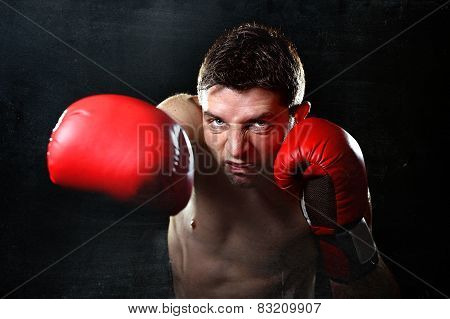 Aggressive Fighter Man Boxing In Red Fighting Gloves Throwing Angry Right Punch