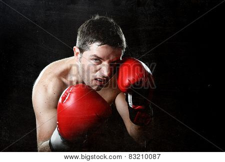 Aggressive Fighter Man Boxing Angry With Red Fighting Gloves Posing In Boxer Stance