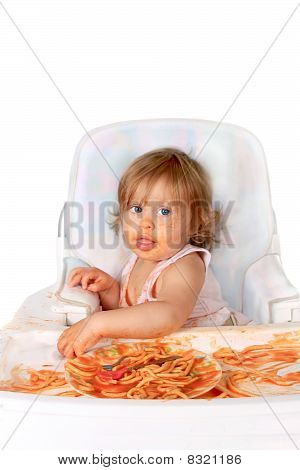 Messy Baby Girl Eating Spaghetti