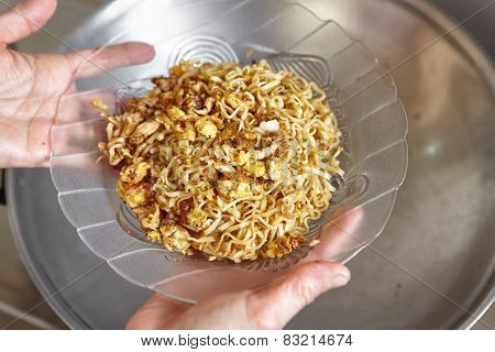 Instant fried noodle with scramble egg ready to be served