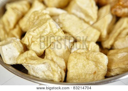 Fried tofu on a plate as ingredient for cooking