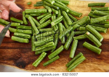 Hand cutting yardlong bean as ingredient for cooking