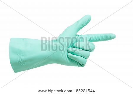 hand with green glove pointing hand to something