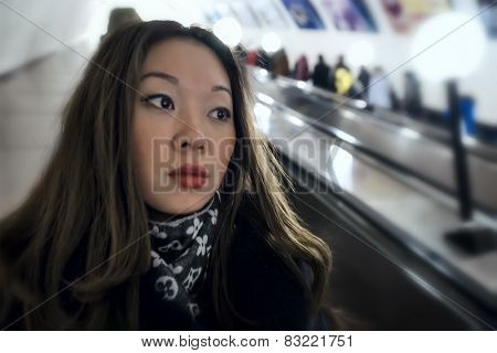 Real portrait of Asian girl on the escalator.
