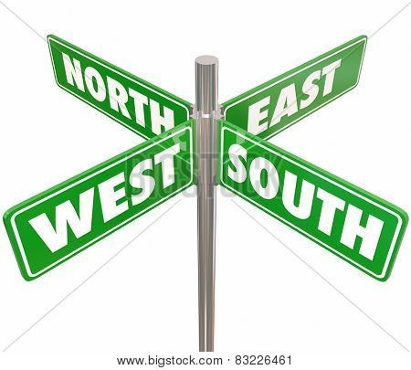 Four green road or street signs marked North, South, East and West to illustrate or point the way for travel to different parts of the country, state, county or city