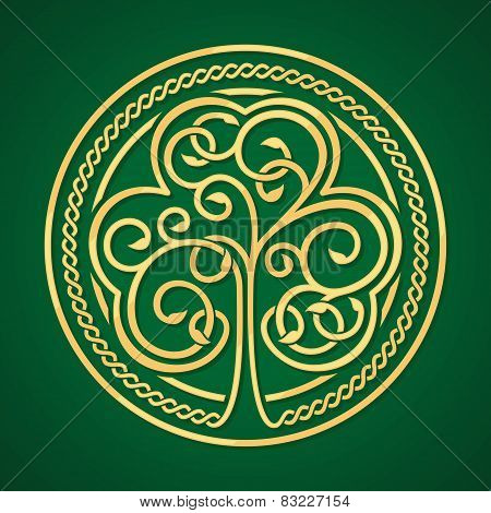 St. Patrick's day. Gold shamrock on a green background