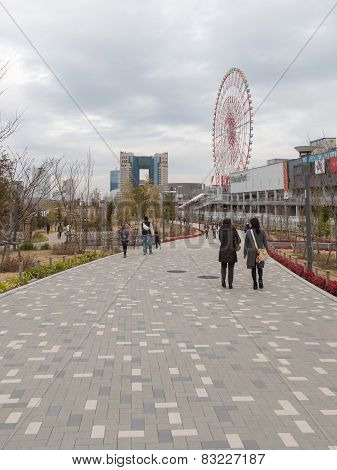 People Walking On A Tiled Path