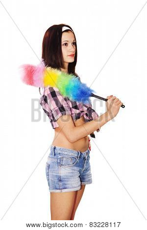 young beautiful woman maid dusting isolated on white background