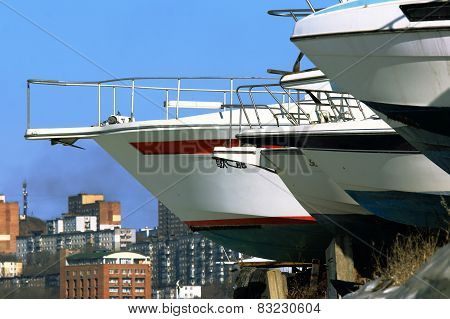 the yacht against the city and the blue sky