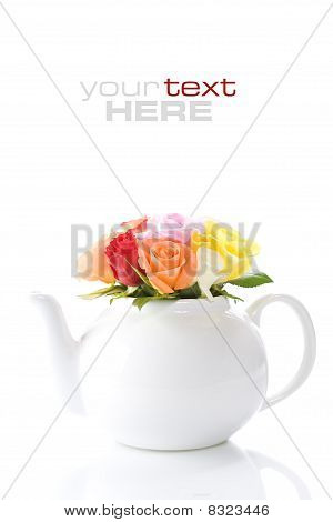 Teapot With A Fresh Roses