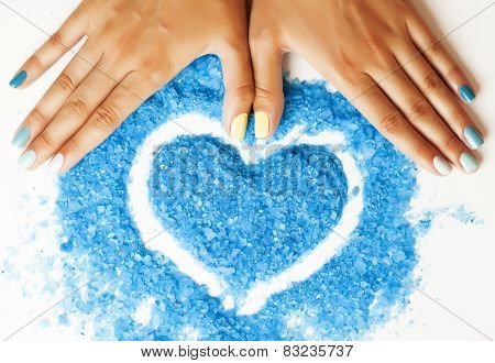 manicure with blue nails and seasalt close up like heart, love f