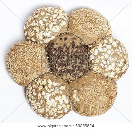 Multigrain brown bread in shape of flower isolated on white