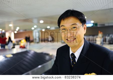 MOSCOW - OCTOBER 12, 2010: Cathay Pacific pilot in Domodedovo airport. Cathay Pacific is the flag carrier of Hong Kong, with its head office and main hub located at Hong Kong International Airport.