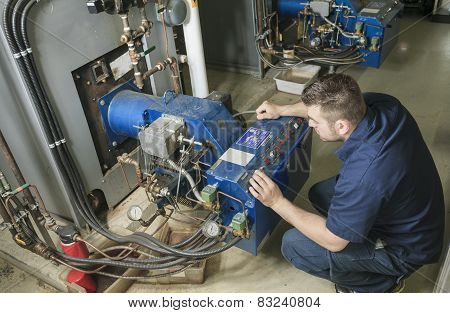 repairman engineer or inspector who check the system.