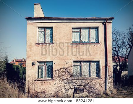 Retro Vintage Filtered Old Neglected House Exterior.
