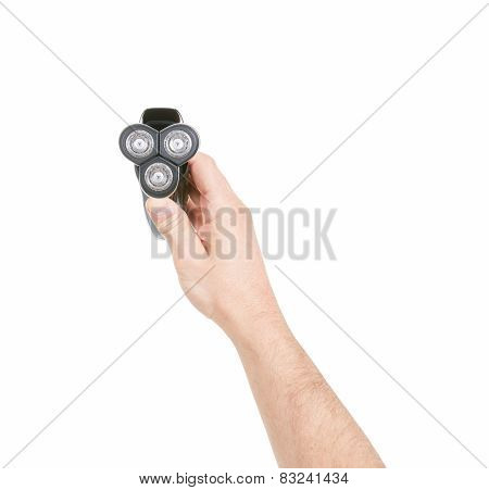 A electric razor in a hand on white background