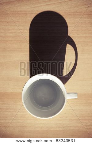 Empty White Ceramic Coffee Cup On Wooden Table Background