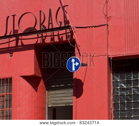 abstract look at red painted building with storage sign