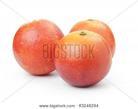 whole ripe blood red oranges isolated on white