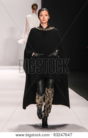 NEW YORK - FEB. 18, 2015: A model walks the runway at the Thomas Wylde Maison fashion show during Mercedes-Benz Fashion Week at The Theatre at Lincoln Center on Feb. 18, 2015 in NYC.