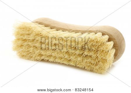 wooden household brush on a white background