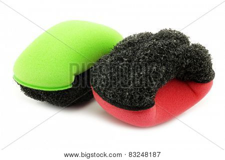 red and green plastic and foam abrasive pads on a white background