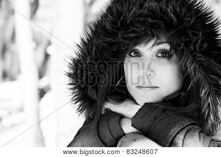 Closeup Portrait Of A Woman Posing In The Snow