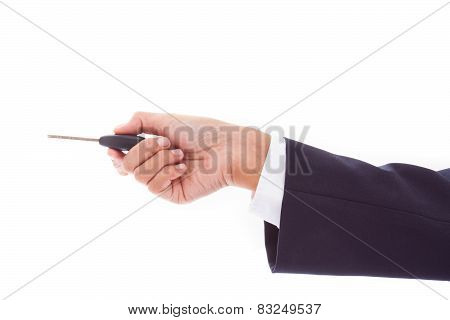 Businessman holding car key isolated