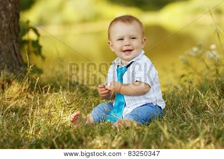 Little Boy Playing In Nature