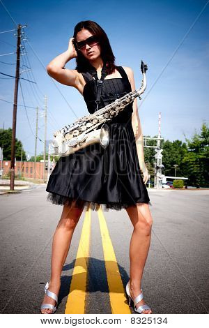 Girl With Sax In Street