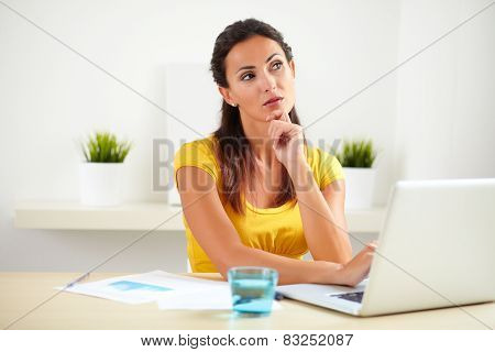 Lovely Secretary Wondering While Sitting In Office