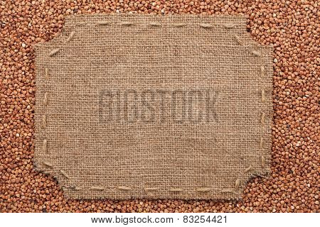 Figured Frame With Burlap And Stitches With  Place For Your Text Lying On Buckwheat  Grains