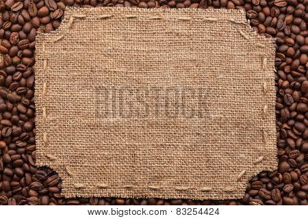 Figured Frame With Burlap And Stitches With  Place For Your Text Lying On Coffee Beans