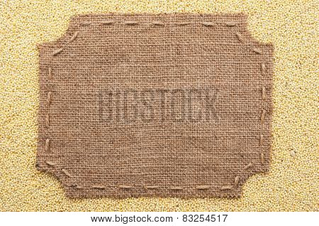 Figured Frame With Burlap And Stitches With  Place For Your Text Lying  On Millet  Grains