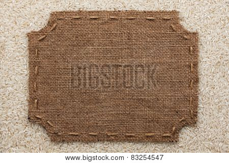Figured Frame With Burlap And Stitches With  Place For Your Text Lying On Rice  Grains
