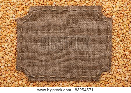 Figured Frame With Burlap And Stitches With  Place For Your Text Lying On Pea  Grains