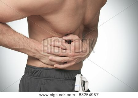 A men holding hands on his stomach