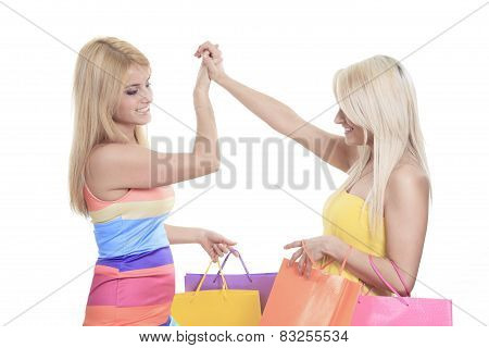 A Happy female shoppers smiling - isolated over a white backgrou