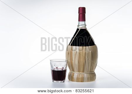 Old Bottle And Glass Of Chianti Wine