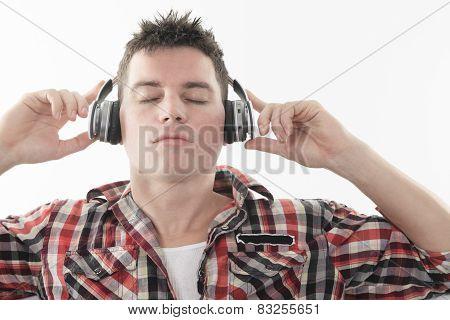 A Handsome guy enjoying music on headphones,