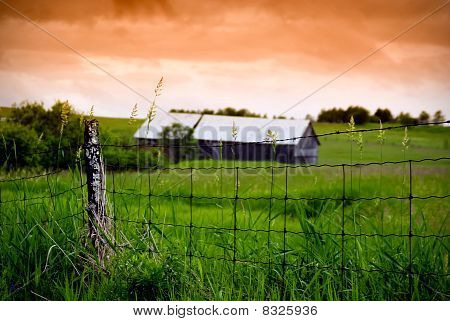Old Wire Fence And Barn