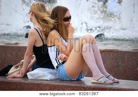 Two girls at fountains.