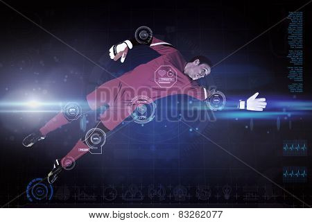 Fit goal keeper jumping up against blue dots on black background