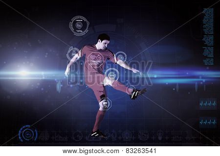 Football player in yellow kicking against blue dots on black background