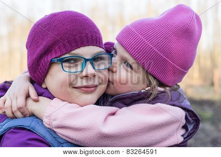 Sister Lovingly Kissing Her Older Sister