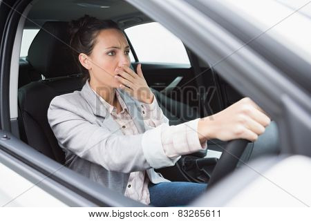 Nervous businesswoman crashing her car during her trip
