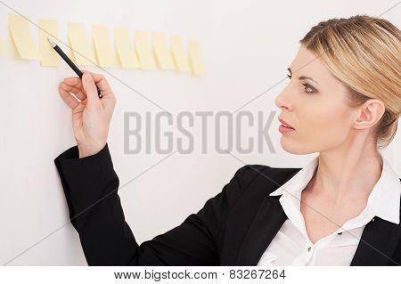 Planning Her Work.