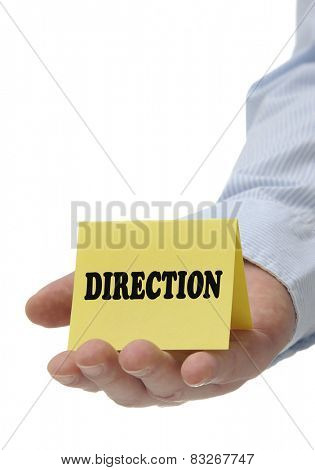 Business man holding yellow direction sign on hand